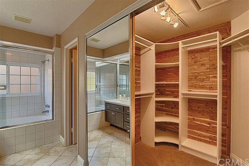 Lots of light & built ins in the master walk in storage.