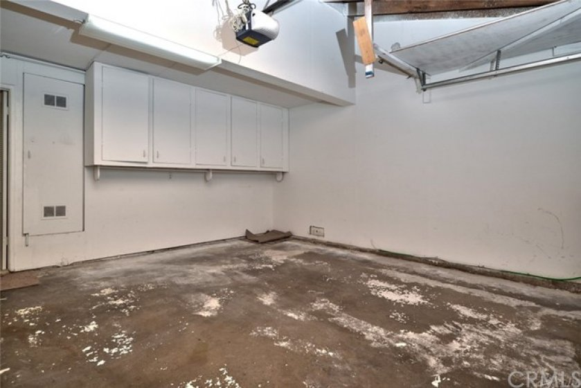 This big 2 car garage has direct access to the home, a garage door opener and storage cabinets.