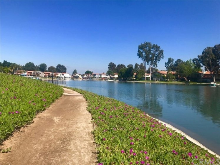 With the HOA includes access to the lake with walking trail around the lake.  During seasonal months, you can check out a paddleboard.    Also included in HOA is Pool/Spa. Tennis Courts that are currently closed due to COVID