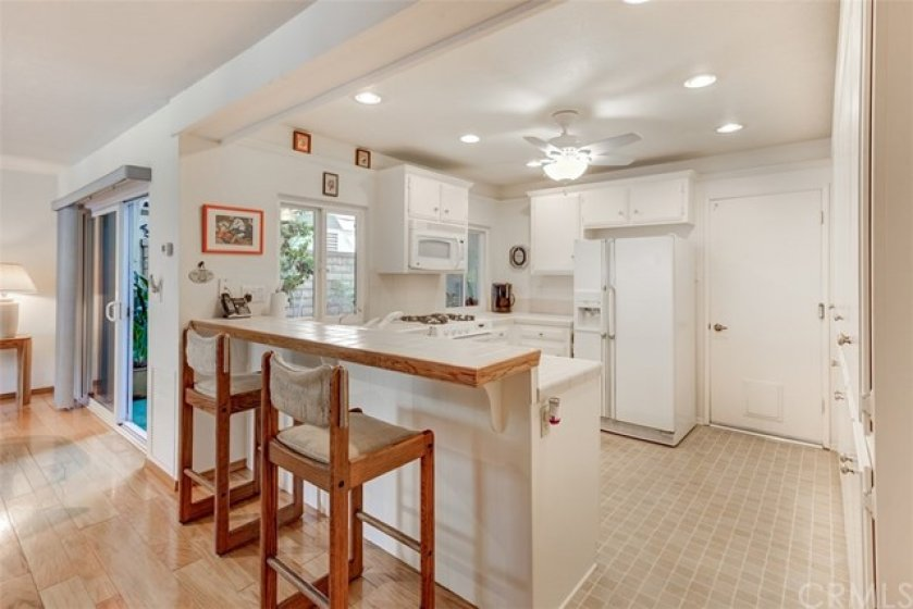 Large Kitchen with recessed lighting, and windows that open to your private patio.