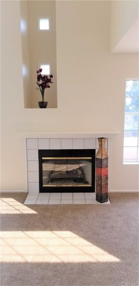 Pretty Fireplace In Living Room with Mantel