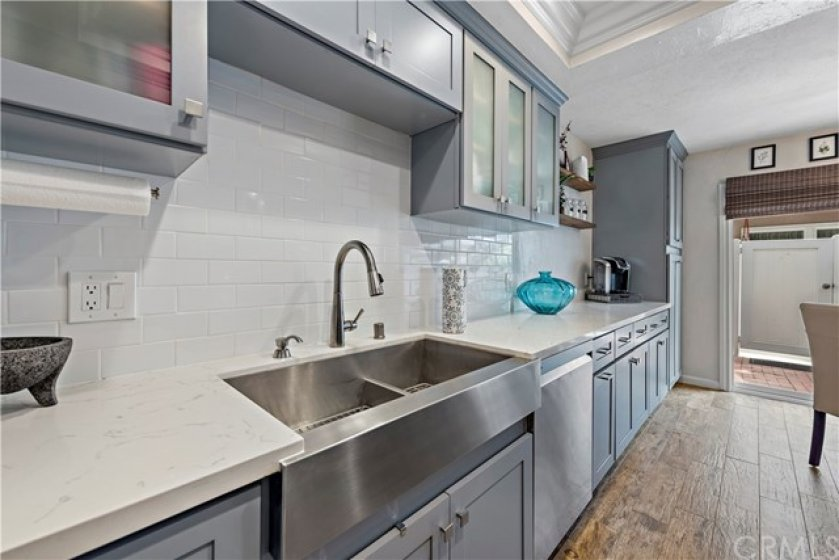 Large dual farmhouse stainless sink.