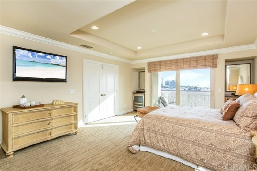 Double doors lead to your private second master suite with built-in mini refrigerator.