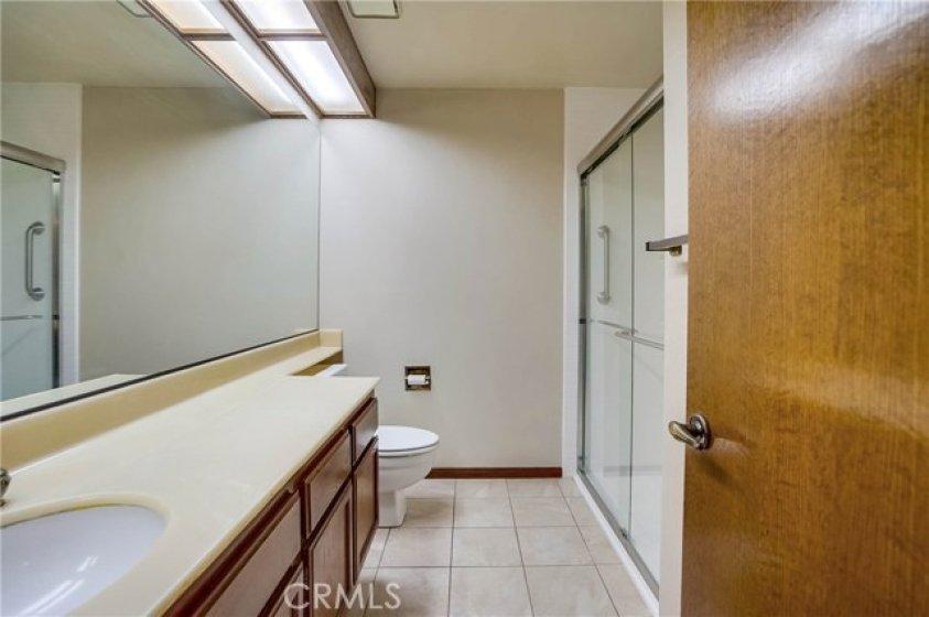 3/4 bathroom with newer walk-in shower.