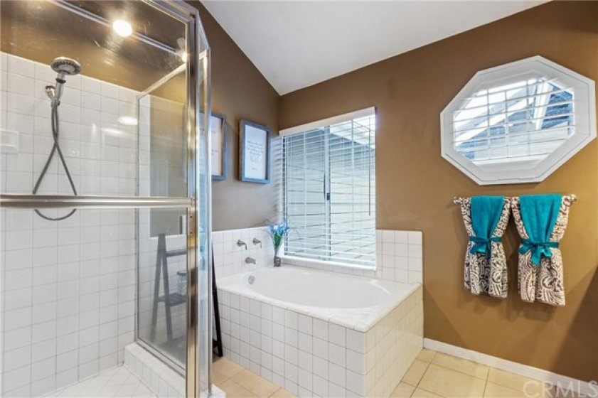 This master bath has a full, tiled shower, deep soaking tub and easy care tile flooring