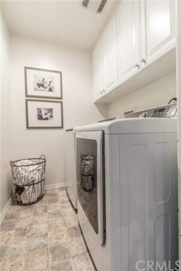 Upstairs laundry with plenty of cabinet space
