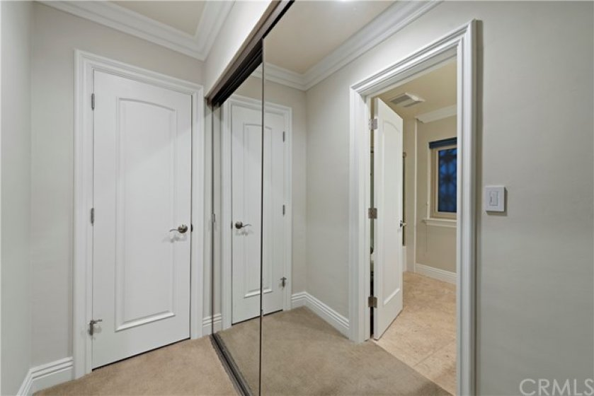 en suite master has 2 closets, one walk-in & one with mirrored doors