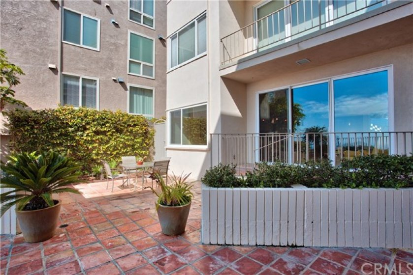 Large outdoor patio outside condo for entertaining.