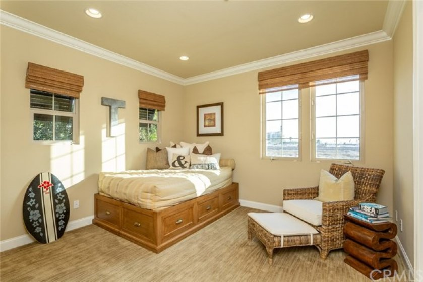 Second floor guest bedroom with own private full bath, walk-in closet, and ocean views.