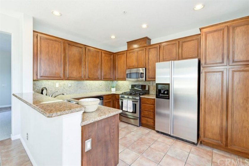 Great kitchen with bar and pantry space.