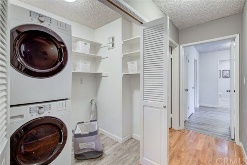 Walk in laundry and storage in hall way.