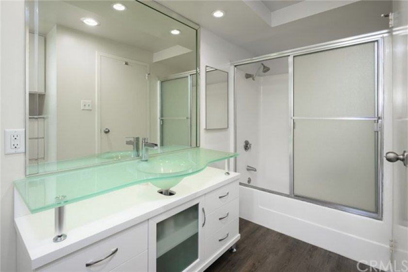 Bathroom with glass vanity