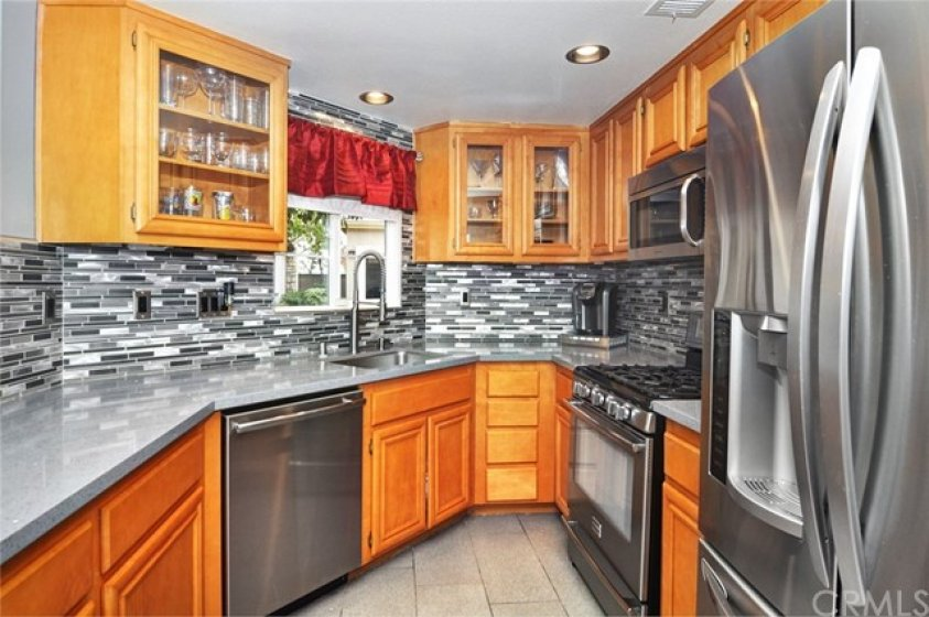Upgraded Corian counter tops, custom back splash,  stainless steel appliances.