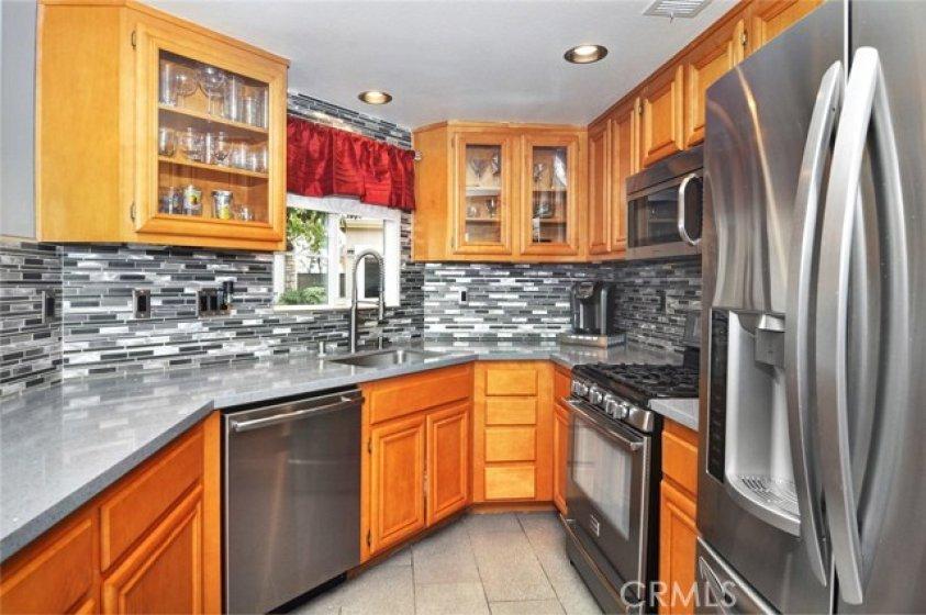 Upgraded Corian counter tops, custom back splash,  stainless steel appliances.