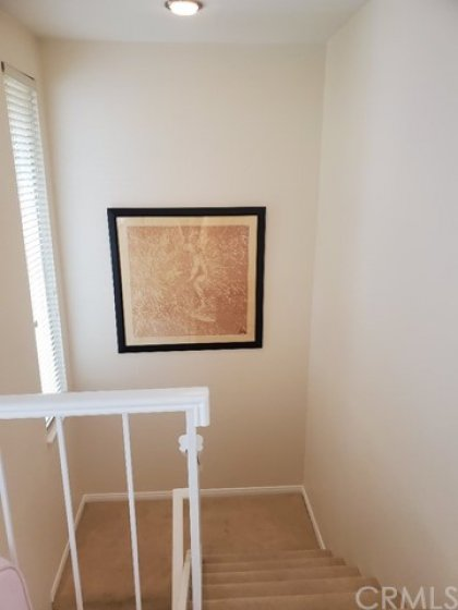 stairs with landing. 2 story with scraped ceilings
