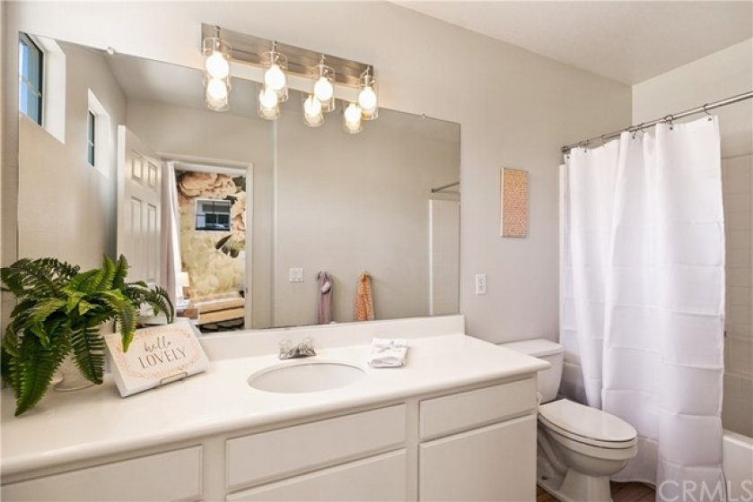 Second Master Bedroom Bathroom with tub and shower! Tiled floors and new lighting!