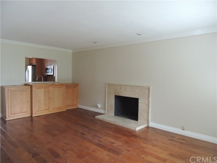 Updated living area with hardwood floors, tiled fireplace, crown moulding and scraped ceilings.  Built-in entertainment center.