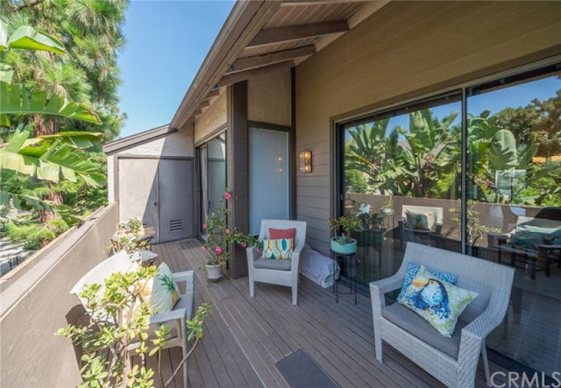 Huge rear balcony with lake views and laundry closet