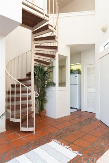 Spiral staircase leads to two rooms, Office and 2nd bedroom? Exercise room? Library? Many options.