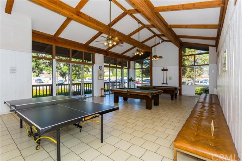 Recreation room with billiard and ping pong tables