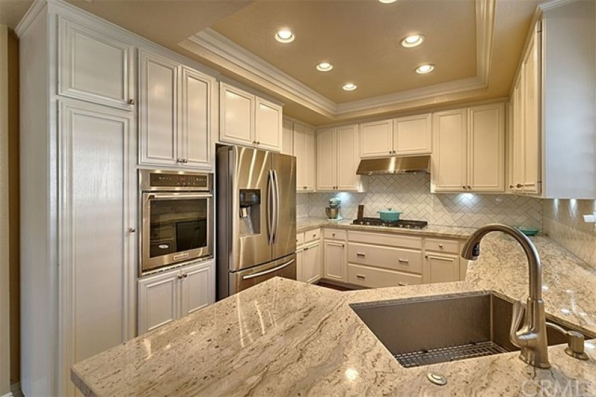 Storage, stainless appliances, pantry, built in range and oven.