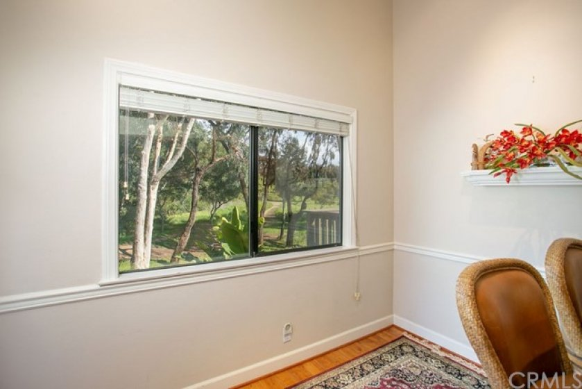 Breakfast nook area with view of trees.