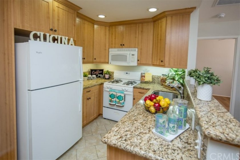 granite counters, tile flooring, updated cabinetry with soft close drawers