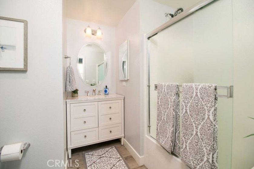The downstairs bathroom is a full bath.