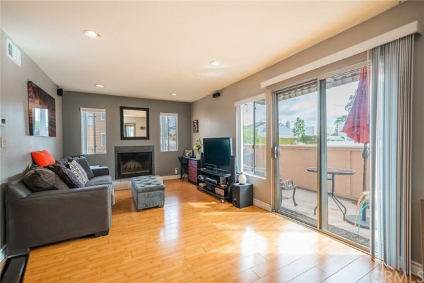Open floor plan concept family room with a spacious sliding door leading to a relaxing and private balcony.