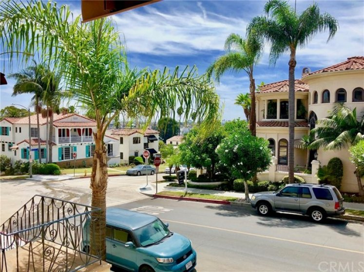 View from Living room window: Lush upscale neighborhood, but mere blocks to the lively 2nd street and a short walk or bike ride to volleyball and sun bathing (with plenty of sunscreen, of course)