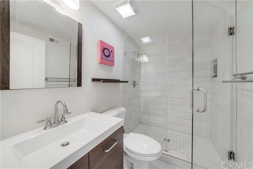 Gorgeous bathroom with sleek vanity and walk-in shower.