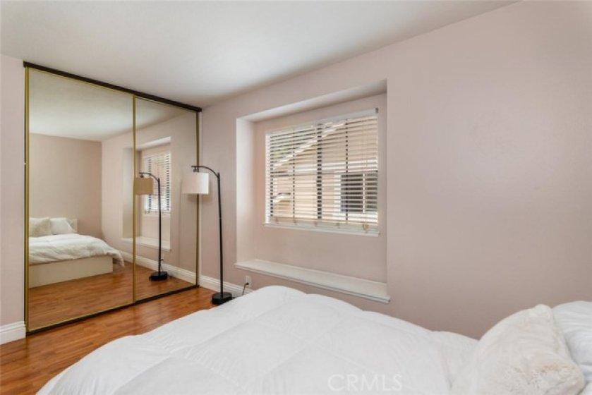 Second bedroom with mirrored wardrobe doors.