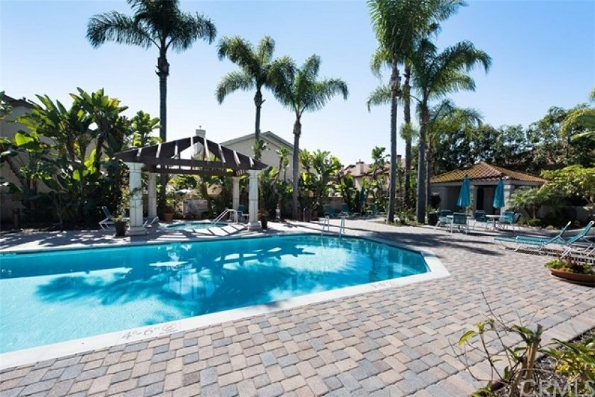 Community pool and spa with lush tropical grounds to enjoy the sun