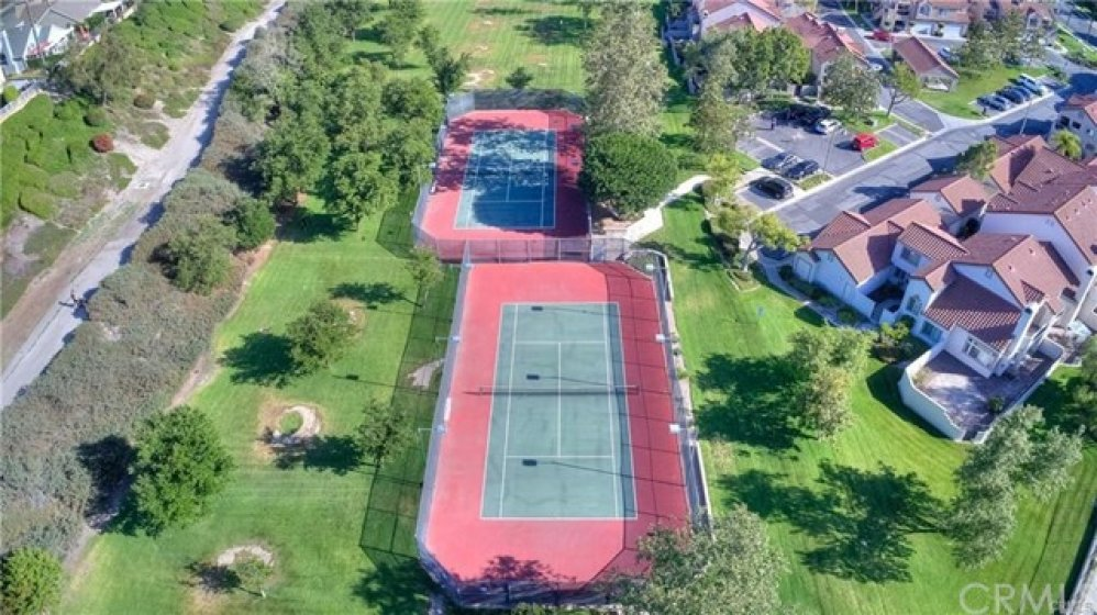 Community offers two tennis courts and large green space!