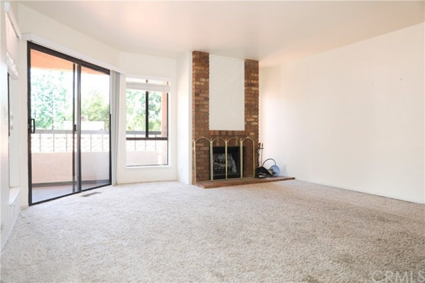 living room with wood burning fireplace and slider to patio