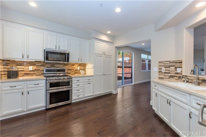 Freshly painted kitchen! Chefs kitchen with a room for a center island ~ Double oven and 4 burner stove with griddle ~