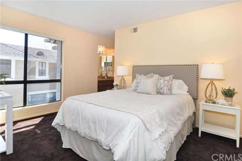 Generous sized 2nd bedroom on 2nd level of home, large window, attached bath