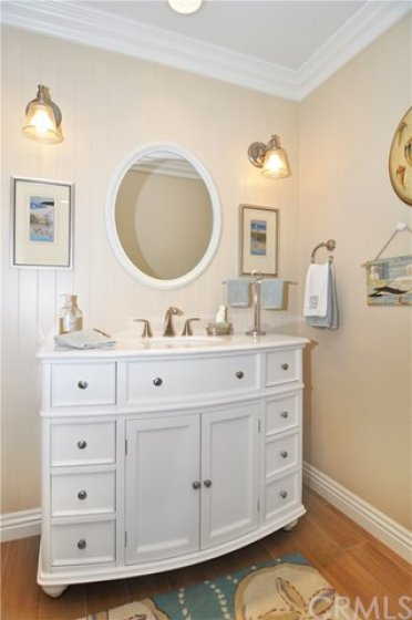Furniture hall bath vanity.