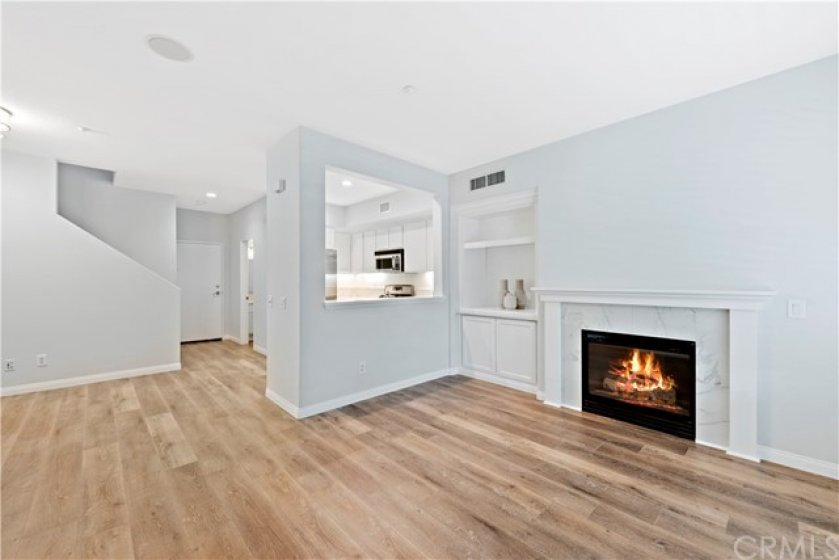 Open concept with living room to enjoy your media set up in custom built in, dining room space and upgraded and remodeled kitchen.