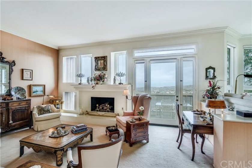 Spacious Living Room with Fireplace and Gorgeous View overlooking the reservoir and mountains