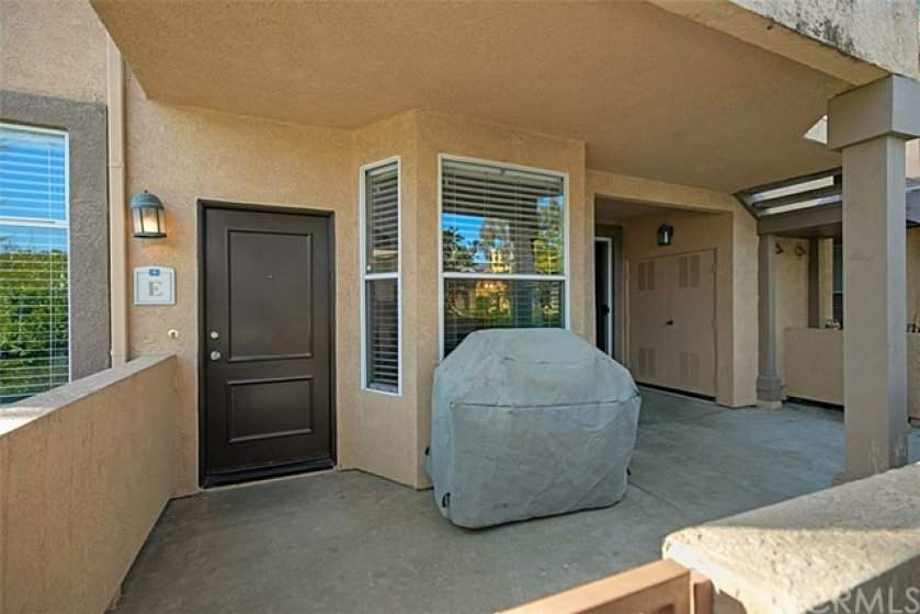 Covered, gated patio for outdoor entertaining
