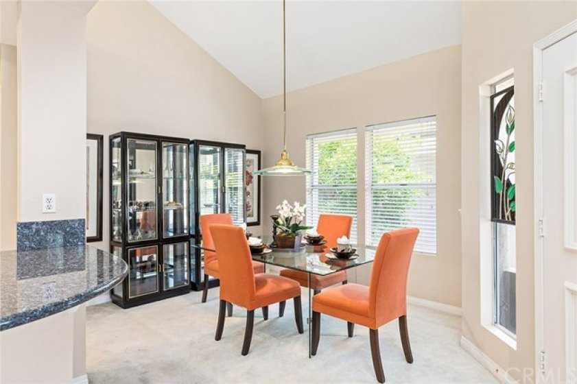 Formal dining room with high ceilings, lots of natural light and easy access to the kitchen.