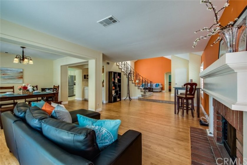 There's so much open space and so many ways to use it!  This originally being called the living room, there's a cozy brick fireplace for cool nights.