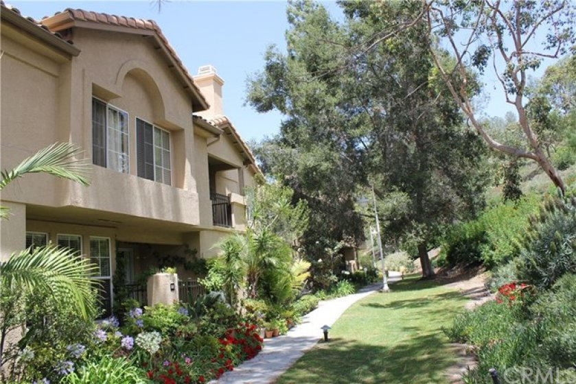 Premium Location on large greenbelt with view of landscaped slope with trees.