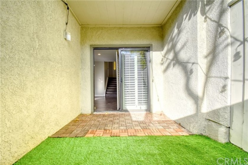 Back patio with artificial turf directly accessed from living room.