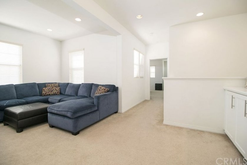 Upstairs, enjoy the loft for an additional living space. Make it an office or even a bedroom if needed.