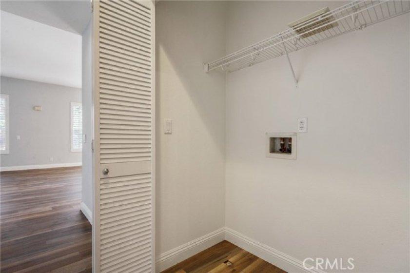 Convenient indoor laundry in main level hallway