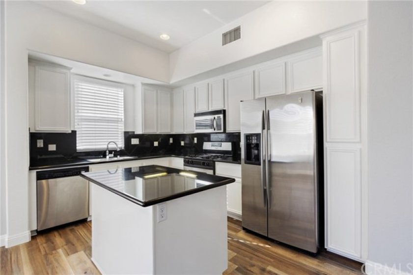 White cabinets compliment the bright & open feel of the home