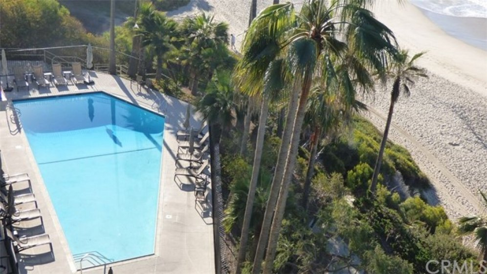 Association Pool and spa, patio and adjoining fitness room.  Direct access to the beach to the right, privately gated access
