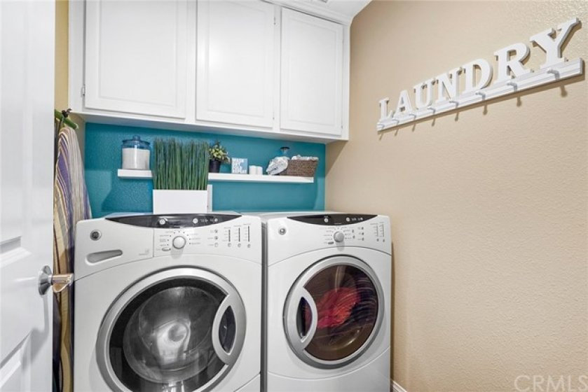 Individual laundry room & over-sized storage area provide both convenience & simplicity